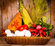 Assorted vegetables and eggs on a basket Royalty Free Stock Image