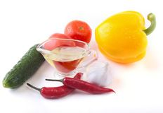 Assorted vegetables, fresh bell pepper, tomato, chilli pepper, cucumber, olive oil, garlic and lettuce isolated on white Royalty Free Stock Image