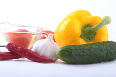 Assorted vegetables, fresh bell pepper, tomato, chilli pepper, cucumber, olive oil, garlic and lettuce isolated on white Royalty Free Stock Photography