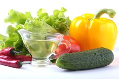 Assorted vegetables, fresh bell pepper, tomato, chilli pepper, cucumber, olive oil and lettuce isolated on white Stock Photos