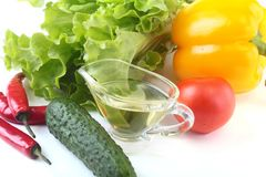 Assorted vegetables, fresh bell pepper, tomato, chilli pepper, cucumber, olive oil and lettuce isolated on white Stock Photography
