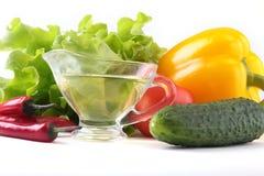 Assorted vegetables, fresh bell pepper, tomato, chilli pepper, cucumber, olive oil and lettuce  on white Royalty Free Stock Photo