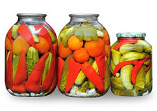 Assorted vegetables in glass jars Royalty Free Stock Photo