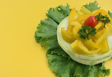 Assorted vegetables laid out on the leaves of the salad stock photography