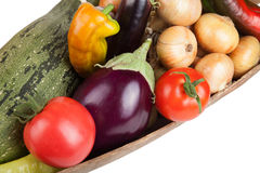 Assorted vegetables lying in a wooden scoop isolated on white ba Royalty Free Stock Image