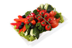 Assorted vegetables on plate isolated on white background. Stock Photos