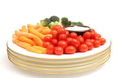 Assorted vegetables on plate w/dip center Royalty Free Stock Image