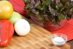 Assorted veggies on fine wood cuttingboard Stock Images