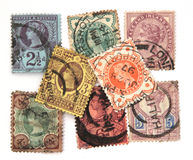 Assorted Victorian postage stamps. On a white background Stock Image