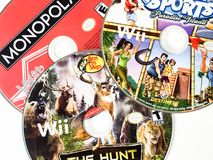 Video Game Discs. Assorted video game discs for the Wii systems.  Endless of hours of fun for the family Royalty Free Stock Images