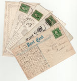 Assorted Vintage Postcard Fan 1900's. Five vintage post cards arranged in a fan shape.  1 cent stamp, dated from 1909 to 1920 Royalty Free Stock Photos