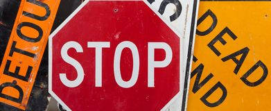 Assorted vintage traffic signs. Old, vintage traffic signs including a stop sign, a detour sign, and a dead end sign making a background. Caution theme stock image