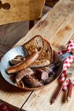 Assorted wild boar and deer fillets and sausages royalty free stock photography