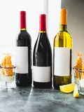 Assorted wine drinks in bottles. Alcoholic drinks in restaurant Stock Photography
