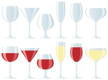 Assorted wine glasses. Group of glasses, empty and filled with red and white wine Stock Photos