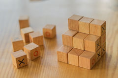 Assorted wooden blocks used to create a staircase to success and Royalty Free Stock Photo