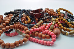 Assorted wooden jewellery. With a light blue background Stock Photo