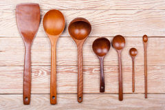 Assorted wooden tableware on wooden table Royalty Free Stock Photos