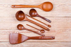 Assorted wooden tableware on wooden table Stock Image