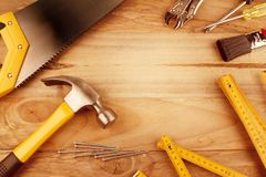 Assorted work tools. On wood Royalty Free Stock Images