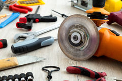 Assorted work tools on white wood Stock Image