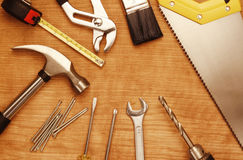 Assorted work tools. On wood Royalty Free Stock Photo