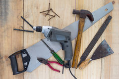 Assorted work tools on wood background Stock Photography