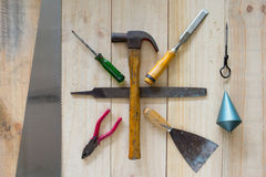 Assorted work tools on wood background Royalty Free Stock Photography