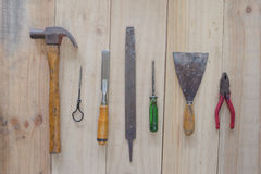 Assorted work tools on wood background Stock Images