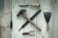 Assorted work tools on wood background,vintage image Royalty Free Stock Image