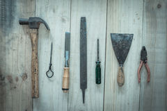 Assorted work tools on wood background,vintage image Royalty Free Stock Images