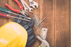Assorted work tools on wood Royalty Free Stock Images