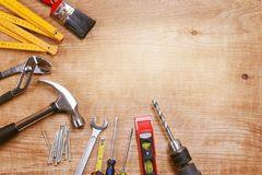 Tools on wooden background. Assorted work tools on wood Stock Images