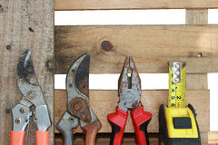 Assorted work tools on wood Stock Photography