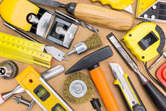 Assorted work tools on wooden background Stock Images
