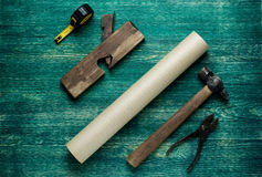 Assorted work tools on wooden background. Top wiew Royalty Free Stock Photography