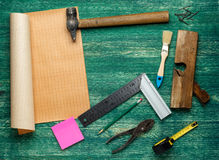 Assorted work tools on wooden background. Top wiew Royalty Free Stock Photo
