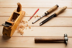 Assorted work tools on woodenn Royalty Free Stock Image