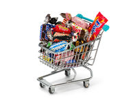 Assorted wrapped chocolate bars in a shopping cart. Royalty Free Stock Images