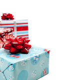 Assorted wrapped Christmas presents on white Royalty Free Stock Image