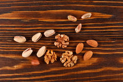 Assorti and mix of nuts pistachios, walnuts, hazelnuts, almonds Stock Photo