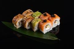 Assorti set sushi roll on banana leaf stock images