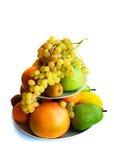 Assortiment van exotische vruchten die op wit worden geïsoleerd Stock Foto