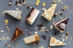 Assortiment van stukken van cake, exemplaarruimte Stock Foto's