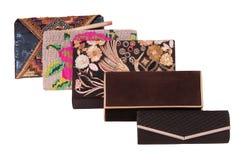 Assortiment van vrouwelijke handtassen, show-venster en modieuze clutc Stock Afbeelding
