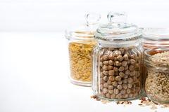 assortimento dei cereali e dei legumi in barattoli di vetro Fotografia Stock