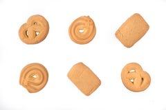 Assortimento di vista superiore dei biscotti di burro danesi isolati su un fondo bianco Immagini Stock