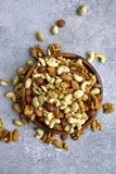 Assortmen of nuts in a wooden bowl - healthy snack.Top view with Royalty Free Stock Photography