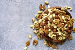 Assortmen of nuts in a wooden bowl - healthy snack.Top view with Stock Photo