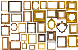 Assortment of art frames. Assortment of golden and silvery art and photo frames isolated on white background Stock Image